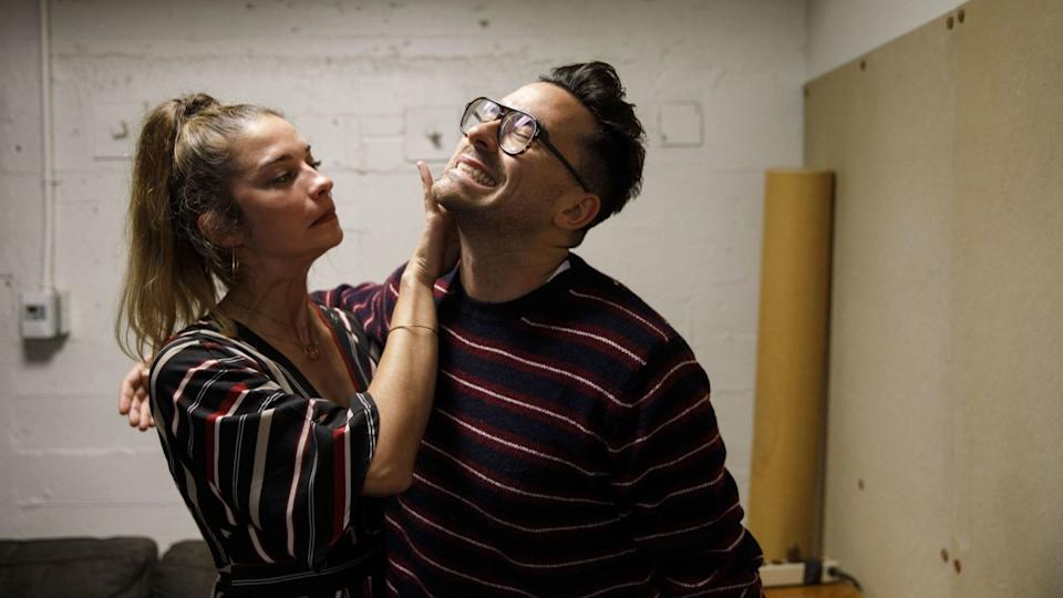 Annie Murphy fusses with Dan Levy before Schitt's Creek Live at the theatre at the Ace Hotel.