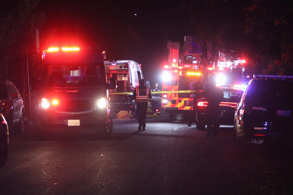 Police and emergency personnel work at the scene of a shooting at a backyard party, Sunday, Nov. 17, 2019, in southeast Fresno, Calif. (Photo: Larry Valenzuela/The Fresno Bee via AP)