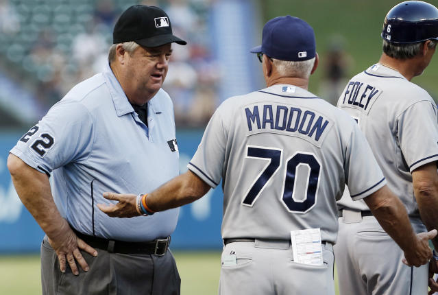 Tampa Bay Rays manager Joe Maddon (70) argues with third base umpire Joe West (22) that a hit by Rays' Curt Casali, not pictured, should be ruled a home run and not a double after bouncing off the left field outfield wall and back into play during the second inning of a baseball game against the Texas Rangers, Wednesday, Aug. 13, 2014, in Arlington, Texas. Upon review the call on the field was confirmed. (AP Photo/Brandon Wade)