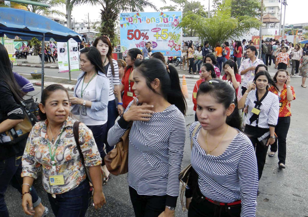 Office workers and residents walk on the street after evacuating from the buildings nearby after an earthquake struck Indonesia's western coast and shook the buildings in Hat Yai district of Songkhla province, southern Thailand Wednesday, April 11, 2012. (AP Photo/Sumeth Panpetch)