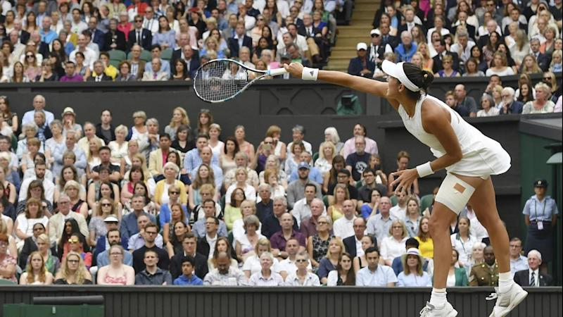 Garbine Muguruza serves on her way to a 7-5 6-0 Wimbledon women's final win over Venus Williams