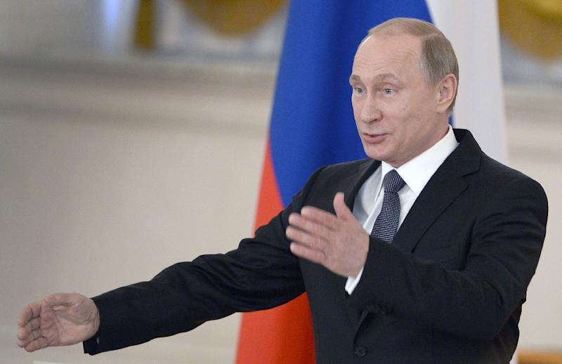 """The United States said it was """"deeply troubled"""" after Russian President Vladimir Putin, pictured, officially enacted a controversial law banning what Moscow deems to be """"undesirable"""" non-governmental organizations"""