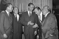 FILE - In this Jan. 24, 1961, file photo, Commissioner Pete Rozelle, center, talks with NFL officials in New York. From left are: Bert E. Rose Jr., of the Minneapolis Vikings; Carroll Rosenbloom of Baltimore Colts; Rozelle; Texas Schramm of the Dallas Cowboys and and Walter Wolfner of the St. Louis Cardinals. The 1960 NFL season was played with 13 clubs, with the expansion Dallas Cowboys joining the league that season and the Chicago Cardinals moving to St. Louis. The Minnesota Vikings were an expansion team the following season. (AP Photo/File)