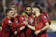 Belgium's Yannick Carrasco, right, celebrates after scoring his side's fourth goal during the Euro 2020 group I qualifying soccer match between Belgium and Cyprus at the King Baudouin stadium in Brussels, Tuesday, Nov. 19, 2019. (AP Photo/Francisco Seco)
