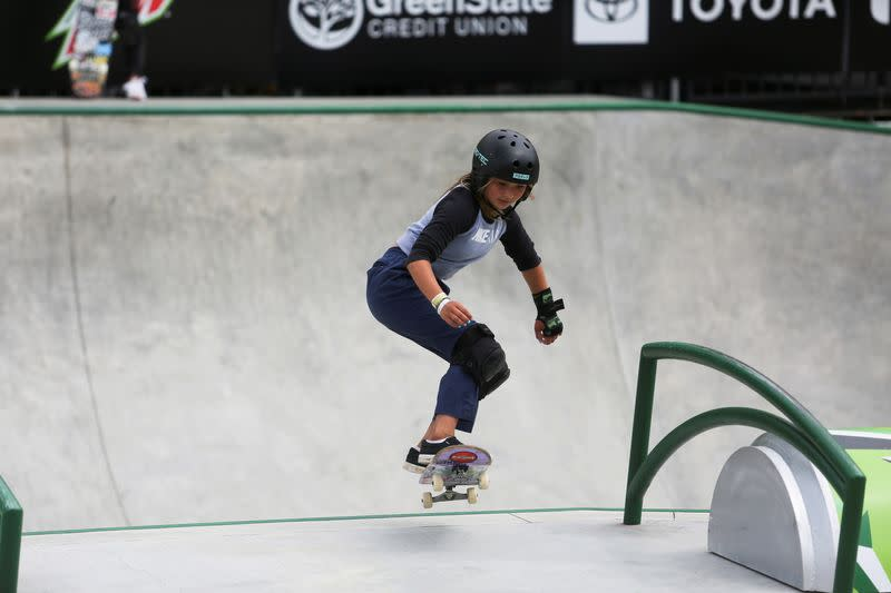 Skateboarders practice during a stop on the Dew Tour