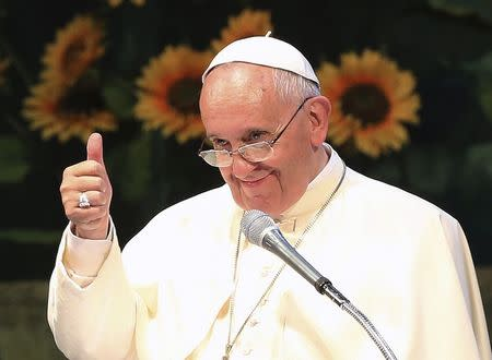 Pope Francis gestures during a meeting with Asian youths at the Solmoe Shrine in Dangjin