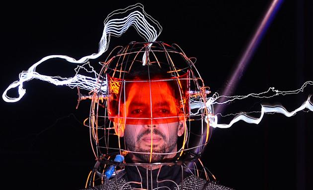 "US Magician David Blaine stands under lighting bolts at the start of his latest performance, ""Electrified"",  in New York, October 05, 2012. Blaine, magician, stuntman and all-round daredevil, hopes to stay standing for three days and nights in the middle of a million volts of fiery electric currents.  AFP PHOTO/Emmanuel DUNAND"