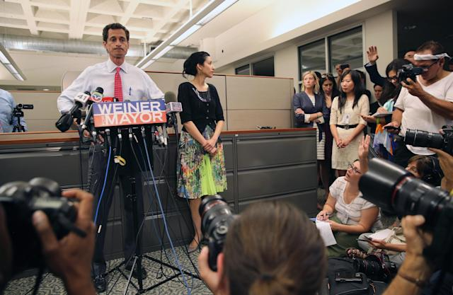 NEW YORK, NY - JULY 23: Anthony Weiner (L), a leading candidate for New York City mayor, stands with his wife Huma Abedin (C) during a press conference on July 23, 2013 in New York City. Weiner addressed news of new allegations that he engaged in lewd online conversations with a woman after he resigned from Congress for similar previous incidents. (Photo by John Moore/Getty Images)