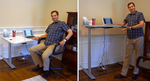 David Pogue sitting and standing at PowerUp desk