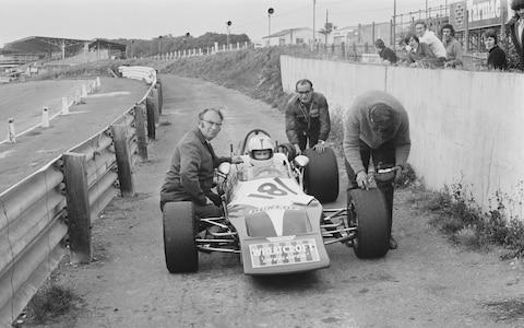 British racing driver Roger Williamson (1948 - 1973) with his backer Tom Wheatcroft (1922 - 2009, left), UK, 15th September 1971. (Photo by Norman Quicke/Daily Express/Getty Images) - Credit: Norman Quicke/Hulton Archive