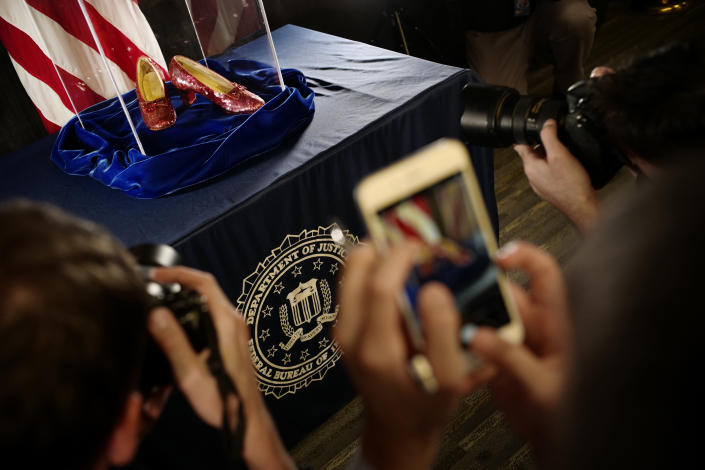 """A pair of ruby slippers once worn by actress Judy Garland in the """"The Wizard of Oz"""" are displayed at a news conference Tuesday, Sept. 4, 2018, at the FBI office in Brooklyn Center, Minn. Authorities announced that the slippers, stolen in 2005 from the Judy Garland Museum in Grand Rapids, Minn., were recovered in a sting operation. The FBI says it has multiple suspects in the extortion and that the investigation continues. Four pairs of ruby slippers worn by Garland in the movie are known to exist. (Richard Tsong-Taatarii/Star Tribune via AP)"""