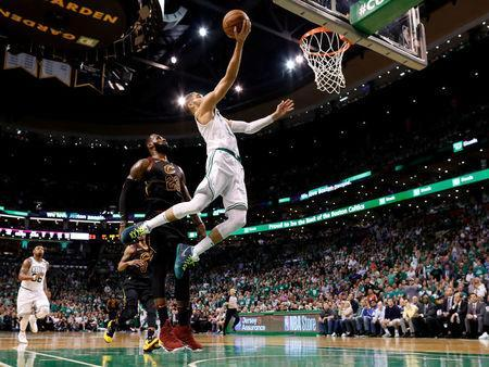 May 23, 2018; Boston, MA, USA; Boston Celtics forward Jayson Tatum (0) attempts a layup in front of Cleveland Cavaliers forward LeBron James (23) during the third quarter of game five of the Eastern conference finals of the 2018 NBA Playoffs at TD Garden. Mandatory Credit: Greg M. Cooper-USA TODAY Sports