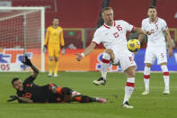 Poland's Kamil Glik, center, and Netherlands' Memphis Depay, left, vie for the ball during the Nations League soccer match between Poland and The Netherlands at Silesian Stadium in Chorzow, Poland, Wednesday, Nov. 18, 2020. (AP Photo/Czarek Sokolowski)
