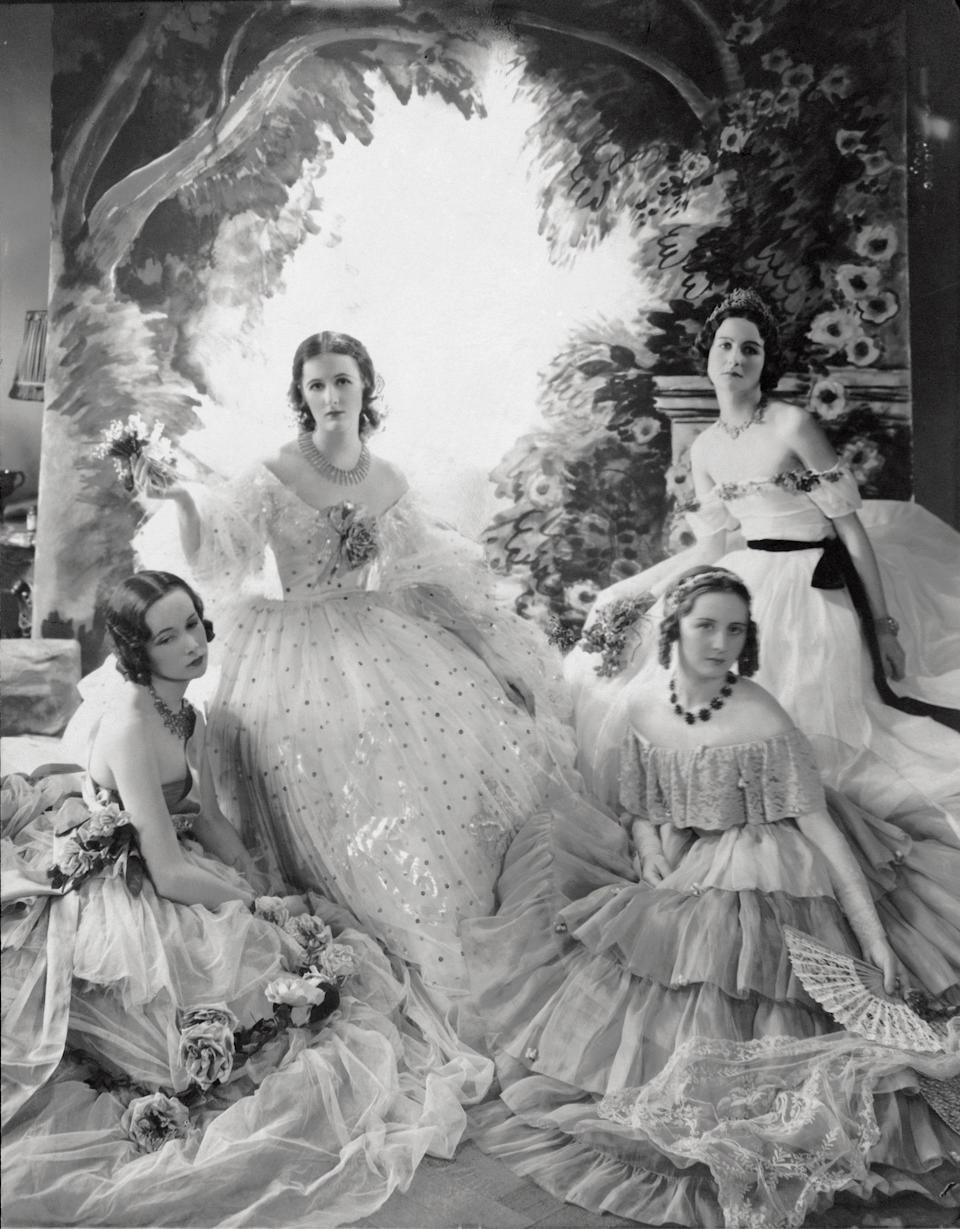 Nancy Mitford (far right) photographed by Cecil Beaton for Vogue in 1931.