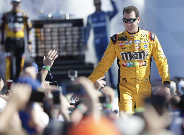 "<a class=""link rapid-noclick-resp"" href=""/nascar/sprint/drivers/947/"" data-ylk=""slk:Kyle Busch"">Kyle Busch</a> greets fans as he is introduced before the NASCAR Daytona 500 Cup series auto race at Daytona International Speedway in Daytona Beach, Fla., Sunday, Feb. 18, 2018. (AP Photo/John Raoux)"