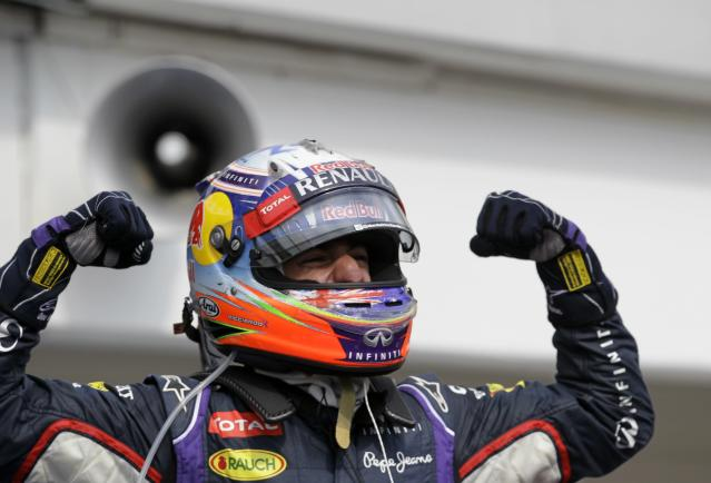Red Bull driver Daniel Ricciardo of Australia celebrates after winning the Hungarian Formula One Grand Prix in Budapest, Hungary, Sunday, July 27, 2014. (AP Photo/Darko Vojinovic)