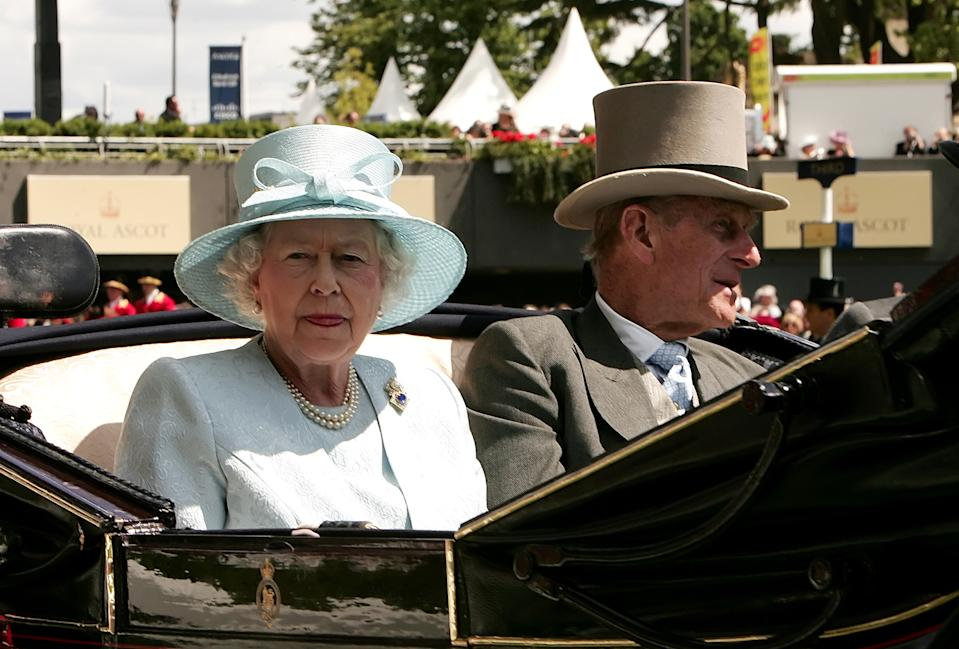 <p>The Queen wore this blue outfit in 2008 at Ascot, but she rewore it a few years later in Malta, proving she is already a re-wearing expert. (Carl de Souza/AFP)</p>