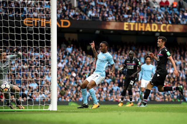 Raheem Sterling scores his side's third goal in a rout of struggling Crystal Palace