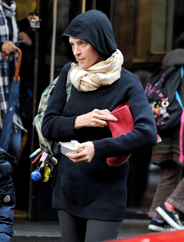 """""""Kill Bill"""" beauty Uma Thurman pulled on a hood to deflect attention while running errands with her son in NYC. Nice try, Uma, but we'd know those perfect features anywhere! Eddie Mejia/<a href=""""http://www.splashnewsonline.com"""" target=""""new"""">Splash News</a> - September 12, 2009"""