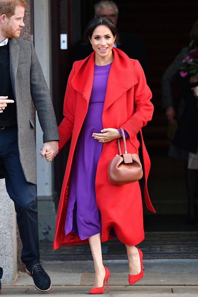 """<a href=""""https://people.com/tag/meghan-markle/"""">Meghan Markle</a> made a bold fashion statement in her first outing of 2019 with <a href=""""https://people.com/tag/prince-harry/"""">Prince Harry</a>, pairing a bright purple dress with a red coat and shoes for a head-turning color combination. The perfect accessory? Her growing baby bump!"""