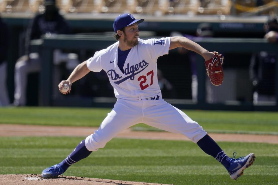 Los Angeles Dodgers starting pitcher Trevor Bauer throws against the Colorado Rockies during the first inning of a spring training baseball game Monday, March 1, 2021, in Phoenix. (AP Photo/Ross D. Franklin)