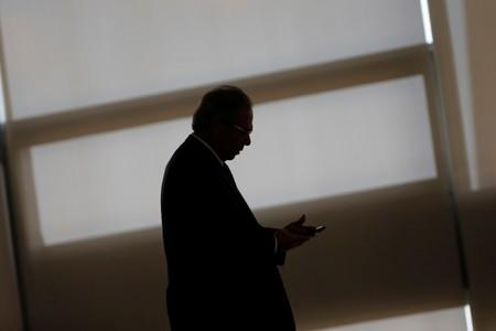 Brazil's Economy Minister Paulo Guedes walks before the ceremony marking his 200 days in office at the Planalto Palace in Brasilia