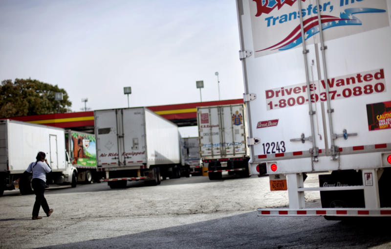 A sign on the back of a truck advertises job openings at a truck stop Tuesday, Oct. 30, 2012, in Atlanta. Even amid a struggling economy with high unemployment, trucking companies had a tough time hiring young drivers willing to hit the road for long hauls. Now the U.S. is speeding toward a critical shortage of truck drivers in the next few years as the economy recovers and demand for goods increases, an expert in the inner-workings of supply chains said in a report Tuesday. (AP Photo/David Goldman)