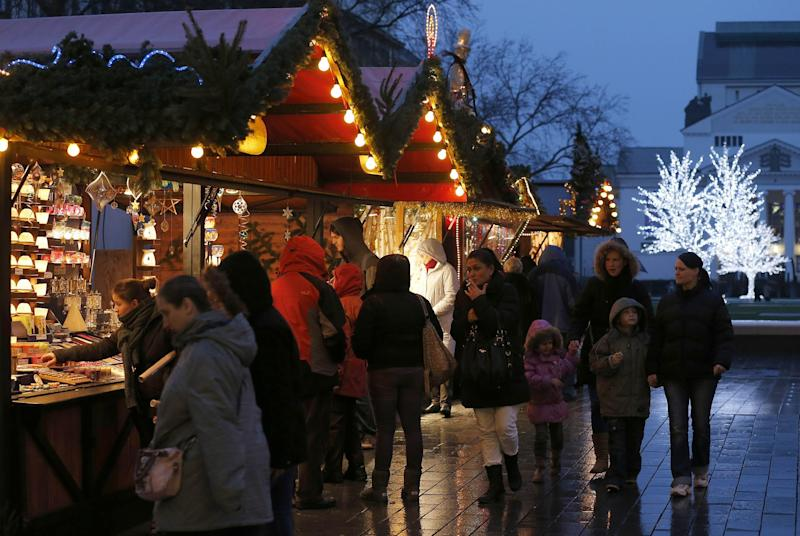 "Shoppers stroll through downtown Duisburg, Germany, Thursday, Dec. 20, 2012. Across Europe, holiday ""shoppers"" this season are doing more browsing than buying. In Rome, some shop for their Christmas presents in sales throughout the year. In Paris, refurbished second-hand toys are attracting buyers.Retailers remain hopeful for a last-minute burst of Christmas consumerism, and some governments are encouraging it by allowing stores to open on Sunday. But with economies across the region slowing and unemployment soaring, analysts say holiday spending in Europe is bound to disappoint for the fourth year in a row. (AP Photo/Frank Augstein)"