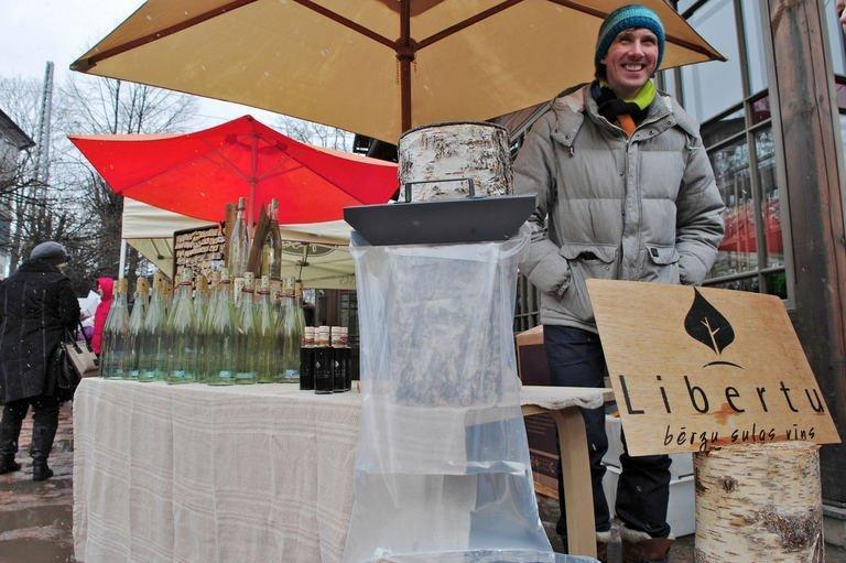 """Linards Liberts sells bottled birch juice and wine at a Kalnciema street market in Riga on March 30, 2013. """"The colder the winter, the sweeter the juice,"""" says the 34-year-old"""
