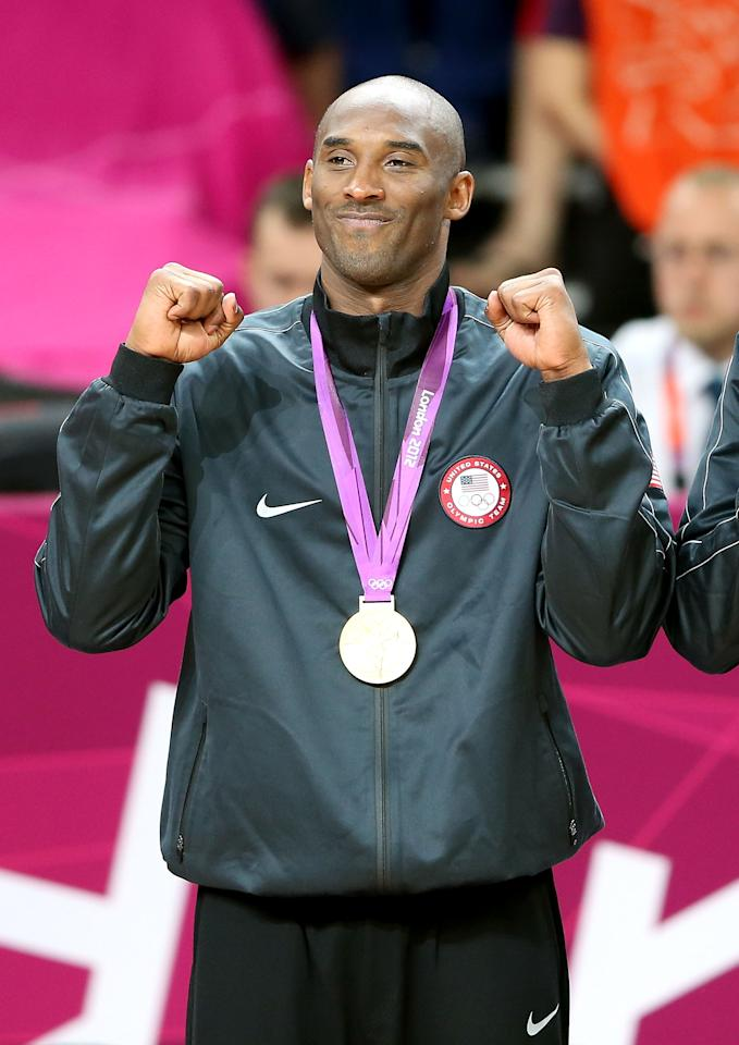 LONDON, ENGLAND - AUGUST 12:  Kobe Bryant #10 of the United States celebrates on the podium during the medal ceremony for the Men's Basketball gold medal game between the United States and Spain on Day 16 of the London 2012 Olympics Games at North Greenwich Arena on August 12, 2012 in London, England.  (Photo by Streeter Lecka/Getty Images)
