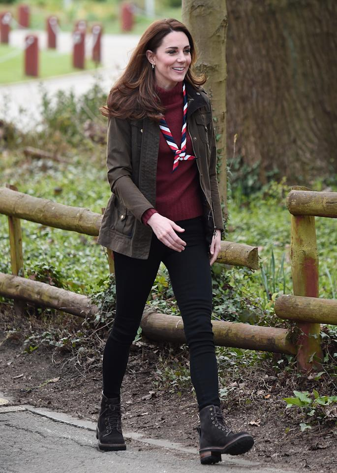 <p>For a trip to the Scouts' headquarters in Epping, the royal wore a plum-hued J. Crew jumper with her go-to Barbour coat. To finish the outdoor ensemble, she wore the UK's official Scouts' neck tie and stompy Chloe boots. <em>[Photo: Getty]</em> </p>
