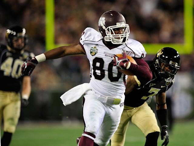 NASHVILLE, TN - DECEMBER 30: Malcolm Johnson #80 of the Mississippi State Bulldogs breaks away from defender Merrill Noel #7 of the Wake Forest Demon Deacons during play at the Franklin American Mortgage Music City Bowl at LP Field on December 30, 2011 in Nashville, Tennessee. (Photo by Grant Halverson/Getty Images)