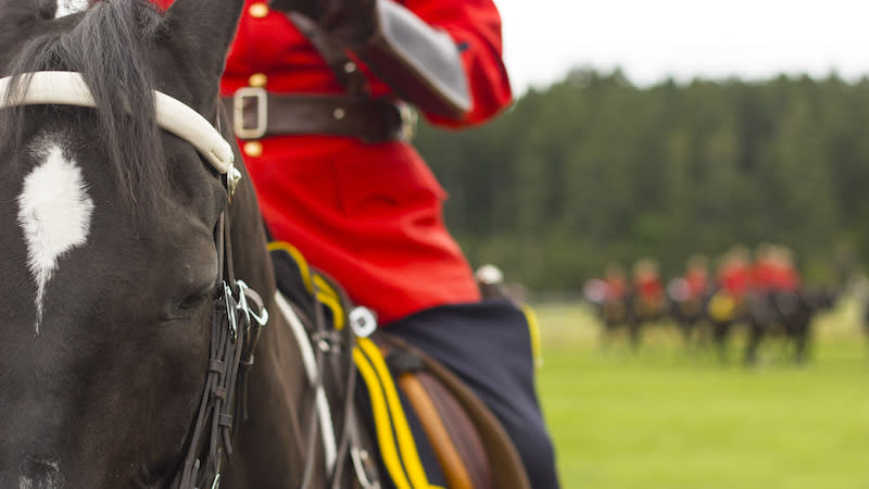 An RCMP officer is seen here on a horse during a training session in Canada. The government has set aside $100,000,000 to pay for a historic class-action lawsuit against the police force. (Getty Images)
