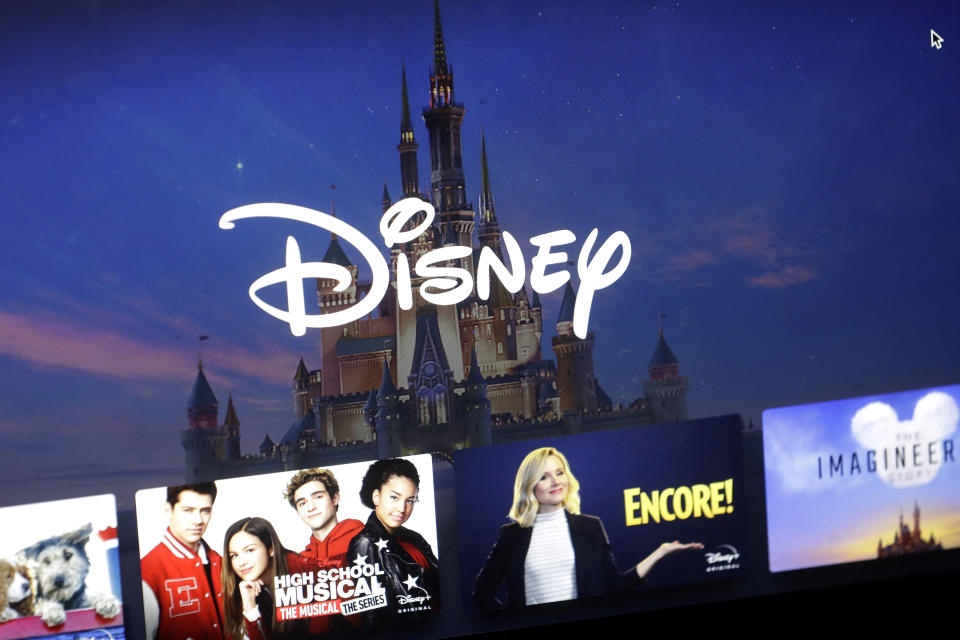 FILE - In this Wednesday, Nov. 13, 2019 file photo, a Disney logo forms part of a menu for the Disney Plus movie and entertainment streaming service on a computer screen in Walpole, Mass.   Analysts predict the entertainment giant's fiscal first-quarter earnings declined from a year earlier, even as revenue increased. Investors will be listening for an update on the company's video streaming service, which launched in November. Disney serves up its results Tuesday, Feb. 4, 2020.  (AP Photo/Steven Senne, File)