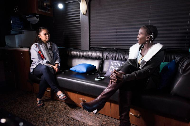 Daniell Datu interviews Nyagoa Wankok on the bus.