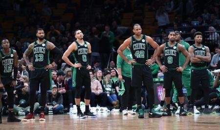 Feb 9, 2019; Boston, MA, USA; Boston Celtics guard Terry Rozier (12) and forward Marcus Morris (13) and forward Jayson Tatum (0) center Al Horford (42) guard Brad Wanamaker (9) and guard Marcus Smart (36) wait for a video review during the second half against the LA Clippers at TD Garden. Bob DeChiara-USA TODAY Sports