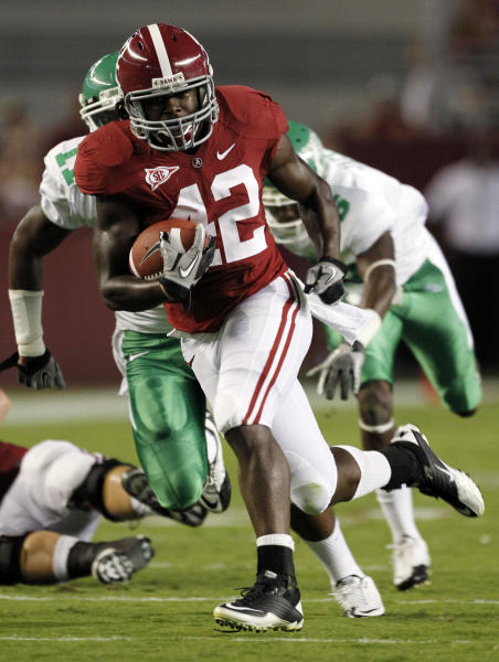 FILE - In this Sept. 17, 2011, file photo, Alabama running back Eddie Lacy (42) scores on a long touchdown run against North Texas defensive back Will Wright (11) during the first quarter of an NCAA college football game at Bryant-Denny Stadium in Tuscaloosa, Ala. With the national championship on the line, two throwback offenses will slug it out. No. 1 Notre Dame and No. 2 Alabama rely heavily on the run, and that doesn't figure to change in the biggest game of the year. (AP Photo/Dave Martin, File)