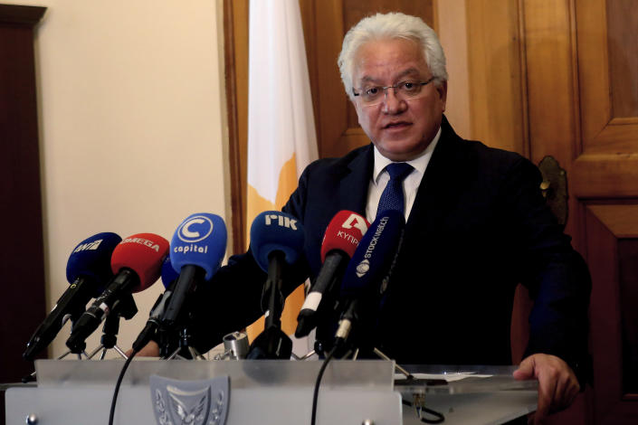 Cyprus' Justice Minister Ioanas Nicolaou talks to the media after a meeting with Cyprus' president Nicos Anastasiades at the presidential palace in capital Nicosia, Cyprus, Thursday, May 2, 2019. Nicolaou has resigned over the case of a serial killer who has confessed to killing seven foreign women and girls amid mounting reports that police had bungled their investigation when some of the victims were initially reported missing. (AP Photo/Philippos Christou)