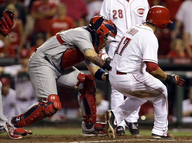 Cincinnati Reds' Shin-Soo Choo (17) is tagged out trying to steal home by St. Louis Cardinals catcher Yadier Molina in the 15th inning of a baseball game, Wednesday, Sept. 4, 2013, in Cincinnati. St. Louis won 5-4 in 16 innings. (AP Photo/Al Behrman)