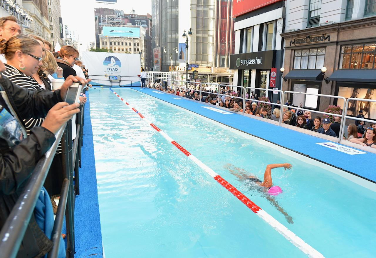 """NEW YORK, NY - OCTOBER 08: Long-distance swim legend Diana Nyad, fresh off her record-braking swim from Cuba to florida swims at day 1 of """"Swim For Relief"""" Benefiting Hurricane Sandy Recovery at Herald Square on October 8, 2013 in New York City. (Photo by Slaven Vlasic/Getty Images)"""