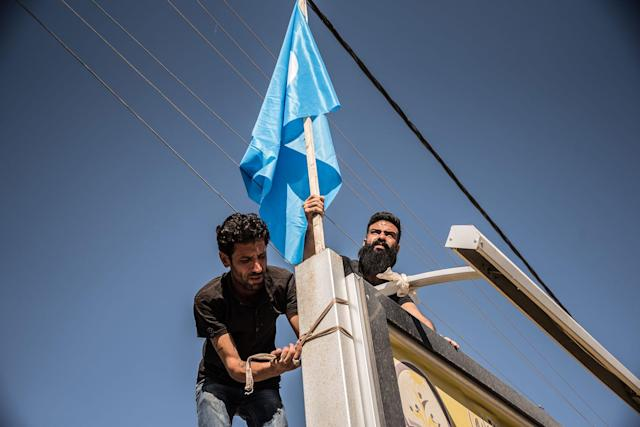 "<p>""We are putting up our flags now that the kurds have gone. We took all theirs down. Since last night we can live peacefully, it will be a better life than before"" Explains Jihad Khalid, a turkman resident of Kirkuk, raising Turkman flags on Oct. 17, 2017, the day after Iranian group Hashd al Shaabi and the Iraqi Army drove the Kurdish Peshmerga out of the city. (Photo: Elizabeth Fitt/SOPA Images/LightRocket via Getty Images) </p>"