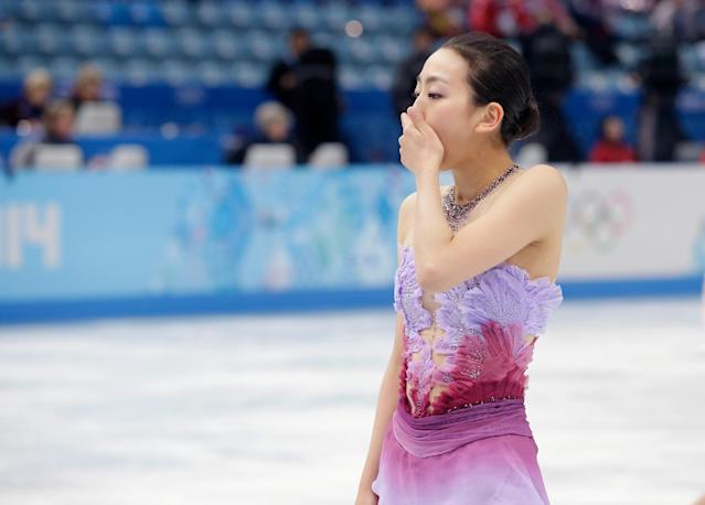 SOCHI, RUSSIA - FEBRUARY 08: Mao Asada of Japan skates off the ice after competing in the Figure Skating Team Ladies Short Program during day one of the Sochi 2014 Winter Olympics at Iceberg Skating Palace on February 8, 2014 in Sochi, Russia. (Photo by Darren Cummings/Pool/Getty Images)
