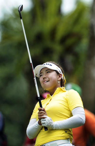 Jenny Shin of South Korea watches her shot on the 14h tee during the final round of the HSBC Women's Champions golf tournament Sunday, Feb. 26, 2012 in Singapore.(AP Photo/Joseph Nair)