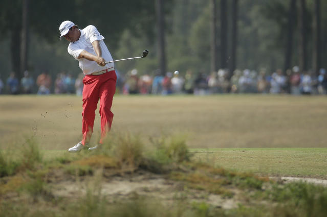 Jason Dufner hits from the fairway on the 16th hole during the second round of the U.S. Open golf tournament in Pinehurst, N.C., Friday, June 13, 2014. (AP Photo/Charlie Riedel)