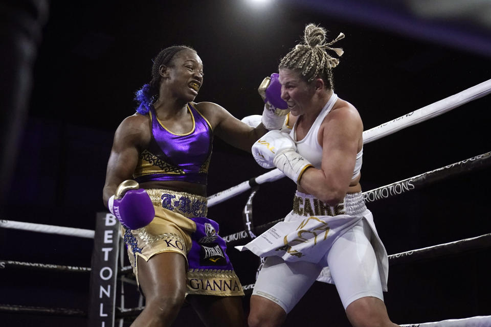 FILE - Claressa Shields, left, hits Marie-Eve Dicaire with a left during the fifth round of a boxing bout for the women's super welterweight title in Flint, Mich., in this Friday, March 5, 2021, file photo. The Professional Fighters League, the only MMA organization with a season format, returns after a year away for a card in Atlantic City. Kayla Harrison and Claressa Shields are among the stars expected to have breakout seasons this year and former UFC champion Anthony Pettis makes his PFL debut on Friday night, April 23, 2021. (AP Photo/Carlos Osorio, File)