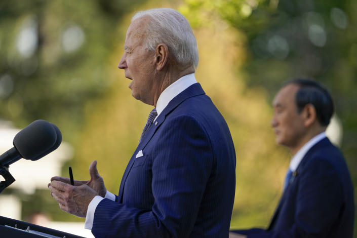 President Joe Biden, accompanied by Japanese Prime Minister Yoshihide Suga, speaks at a news conference in the Rose Garden of the White House, Friday, April 16, 2021, in Washington. (AP Photo/Andrew Harnik)