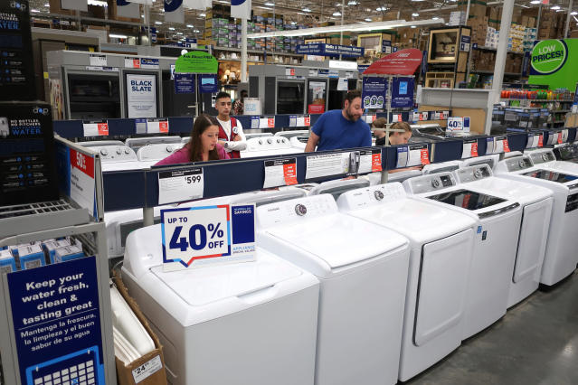A family shops for washing and drying machines at Lowe's Home Improvement store in East Rutherford, N.J. (AP Photo/Ted Shaffrey, File)