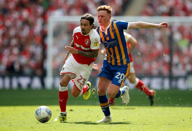 "Soccer Football - League One Play-Off Final - Rotherham United v Shrewsbury Town - Wembley Stadium, London, Britain - May 27, 2018 Rotherham United's Ryan Williams in action with Shrewsbury Town's John Nolan Action Images/Carl Recine EDITORIAL USE ONLY. No use with unauthorized audio, video, data, fixture lists, club/league logos or ""live"" services. Online in-match use limited to 75 images, no video emulation. No use in betting, games or single club/league/player publications. Please contact your account representative for further details."