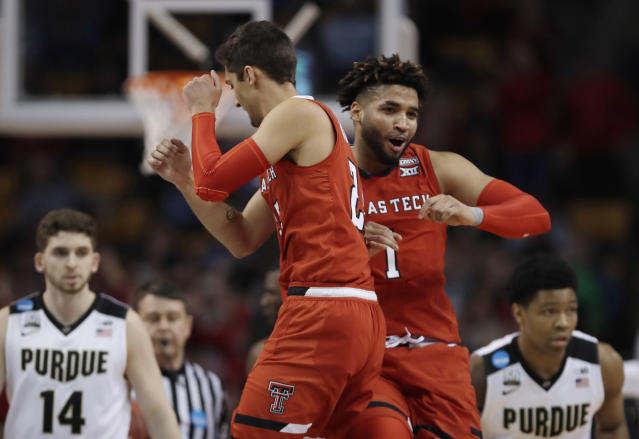 Texas Tech's Davide Moretti, left, and Brandone Francis, right, celebrate a basket during the second half of the team's NCAA men's college basketball tournament regional semifinal against Purdue, Friday, March 23, 2018, in Boston. (AP Photo/Charles Krupa)
