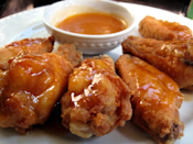 """<p>""""I made these and we ate them all right away. I love the combination of sweet and hot and these fit the bill perfectly.""""<i> -afghanmom</i> <b><a href=""""http://www.food.com/recipe/honey-chipotle-glazed-wings-176107?oc=PTNR-YahooFood-favorite-chicken-wing-recipes"""" rel=""""nofollow noopener"""" target=""""_blank"""" data-ylk=""""slk:Get the Recipe>>"""" class=""""link rapid-noclick-resp"""">Get the Recipe>></a></b><br></p><p><i>Recipe by <a href=""""http://www.food.com/user/142559?oc=PTNR-YahooFood-favorite-chicken-wing-recipes"""" rel=""""nofollow noopener"""" target=""""_blank"""" data-ylk=""""slk:xpnsve"""" class=""""link rapid-noclick-resp"""">xpnsve</a>; Photo by <a href=""""http://www.food.com/user/1072593?oc=PTNR-YahooFood-favorite-chicken-wing-recipes"""" rel=""""nofollow noopener"""" target=""""_blank"""" data-ylk=""""slk:gailanng"""" class=""""link rapid-noclick-resp"""">gailanng</a> </i></p>"""